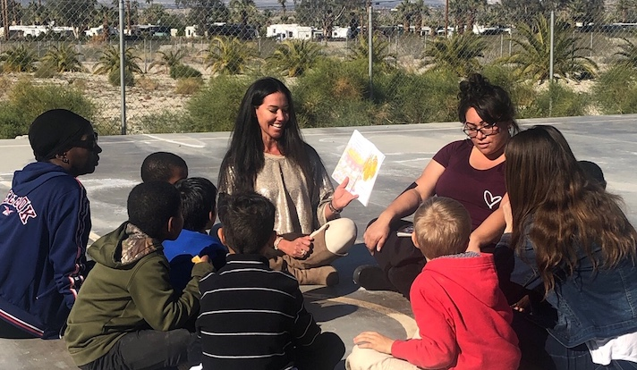 Kelly Levy spends time with children at Father's Heart Ranch